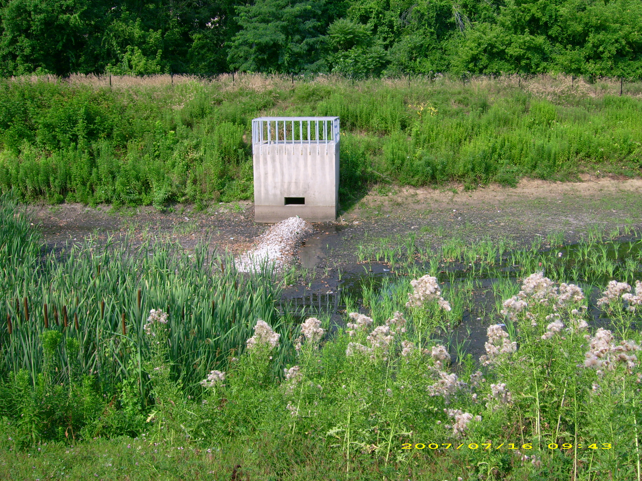 Detention Basin Meaning & Riser In Detention Basin  Concrete